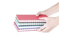 Pilha de disponivel colorido dos cadernos Fotografia de Stock Royalty Free