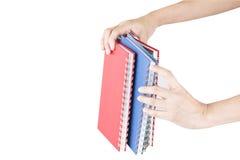 Pilha de disponivel colorido dos cadernos Foto de Stock