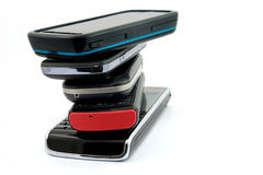 Pilha de diversos telefones móveis Fotografia de Stock Royalty Free