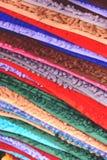 A pilha de esteiras bem-vindas coloridas fecha-se acima imagens de stock royalty free