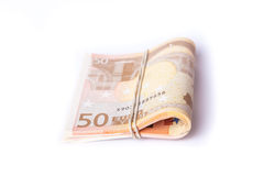 pilha de 50 euro- cédulas envolvida e rolada Foto de Stock