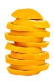 Pilha de fatias alaranjadas no fundo branco Imagem de Stock Royalty Free