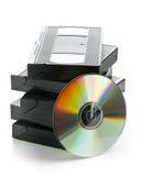 Pilha de gavetas video análogas com disco de DVD Fotografia de Stock Royalty Free