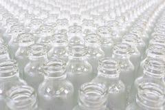 Pilha de Hugh dos frascos de vidro imagem de stock