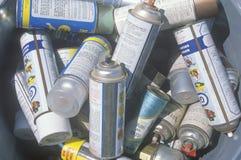 Pilha de latas do aerossol imagem de stock royalty free