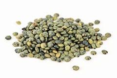 Pilha de lentilhas francesas uncooked Imagem de Stock