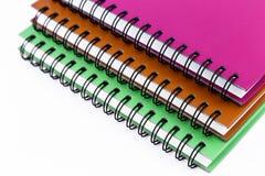 Pilha de livro ou de caderno da pasta de anel isolado imagens de stock royalty free