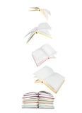Pilha de livros e de livros de voo Fotos de Stock