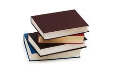Pilha de livros isolados no fundo branco Foto de Stock