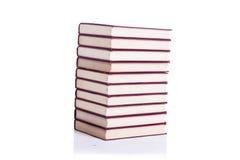 A pilha de livros isolou o fundo branco Imagem de Stock