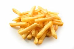 Pilha de microplaquetas de batata fritadas friáveis douradas imagens de stock royalty free