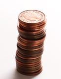 Pilha de moedas de um centavo britânicas Fotos de Stock