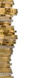 Pilha de moedas do dinheiro contra o fundo branco Fotografia de Stock Royalty Free