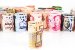 Pilha de notas roladas-acima da moeda com EURO na parte dianteira Foto de Stock Royalty Free