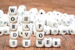 A pilha de palavras tem o enigma dos dados do poder Fotografia de Stock