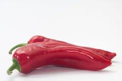 Pilha de paprika vermelhas no fundo branco Imagens de Stock Royalty Free