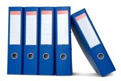 Pilha de pastas de anel azuis. Fotografia de Stock