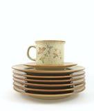 Pilha de placas e de um copo de café Fotos de Stock Royalty Free