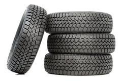 Pilha de quatro pneus do inverno da roda de carro isolados Foto de Stock Royalty Free