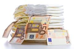 Pilha de tecidos e de cédulas do Euro Fotografia de Stock