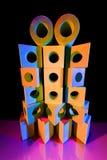Pilha de tijolos do brinquedo na luz colorida Fotografia de Stock Royalty Free