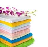 Pilha de toalhas coloridas Imagens de Stock