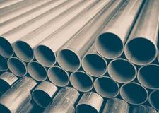 Pilha de tubulações do metal da construção Foto de Stock Royalty Free