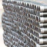Pilha de tubulações rosqueadas Imagem de Stock