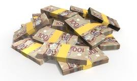 Pilha dispersada notas do dólar canadense Imagem de Stock