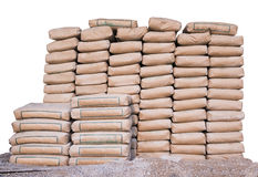 Pilha do cimento nos sacos, empilhada ordenadamente para um projeto de construção Fotografia de Stock Royalty Free