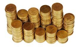 Pilha do dinheiro do ouro isolada no branco Fotografia de Stock Royalty Free