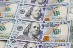 Pilha do fundo do dinheiro $100 dólares Imagens de Stock