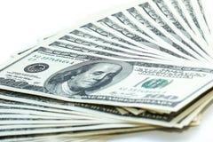 pilha do ventilador de 100 notas de dólar Imagens de Stock