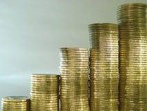 Pilha dobrada das moedas sob a forma das cartas Imagem de Stock