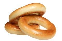 Pilha dos bagels em um fundo branco Imagens de Stock Royalty Free
