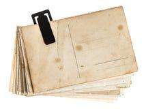 Pilha dos cartão velhos isolados no fundo branco Fotos de Stock Royalty Free