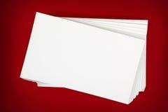 Pilha de cartões sobre o fundo vermelho Fotografia de Stock Royalty Free