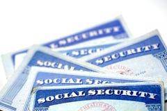 Pilha dos cartões de segurança social em seguido para a aposentadoria Fotografia de Stock Royalty Free