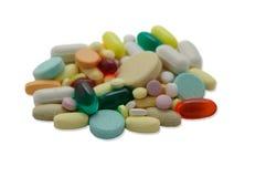 Pilha dos comprimidos coloridos que desvanecem-se para borrar Imagens de Stock Royalty Free