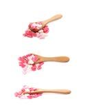 Pilha dos grânulos dados forma coração isolados Fotografia de Stock Royalty Free