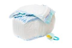 A pilha dos tecidos e do manequim do bebê Imagem de Stock Royalty Free