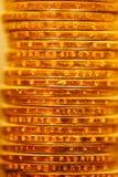 Pilha dourada das moedas do dólar Foto de Stock