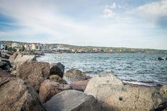 Pilha e lago da rocha Foto de Stock