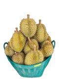 Pilha isolada do Durian ou do rei dos frutos na cesta para a venda no mercado do fundo branco Imagens de Stock
