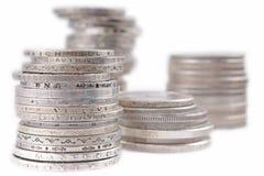 Pilhas das moedas de prata do dinheiro Fotografia de Stock