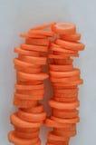 Pilhas de cenouras cortadas Imagens de Stock