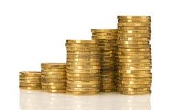 Pilhas de dinheiro do ouro Imagens de Stock