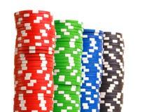 Pilhas de microplaquetas de pôquer coloridas Imagem de Stock Royalty Free