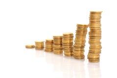 Pilhas de moedas de ouro Foto de Stock
