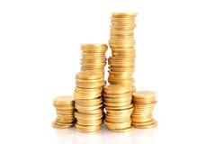 Pilhas de moedas de ouro Fotos de Stock Royalty Free